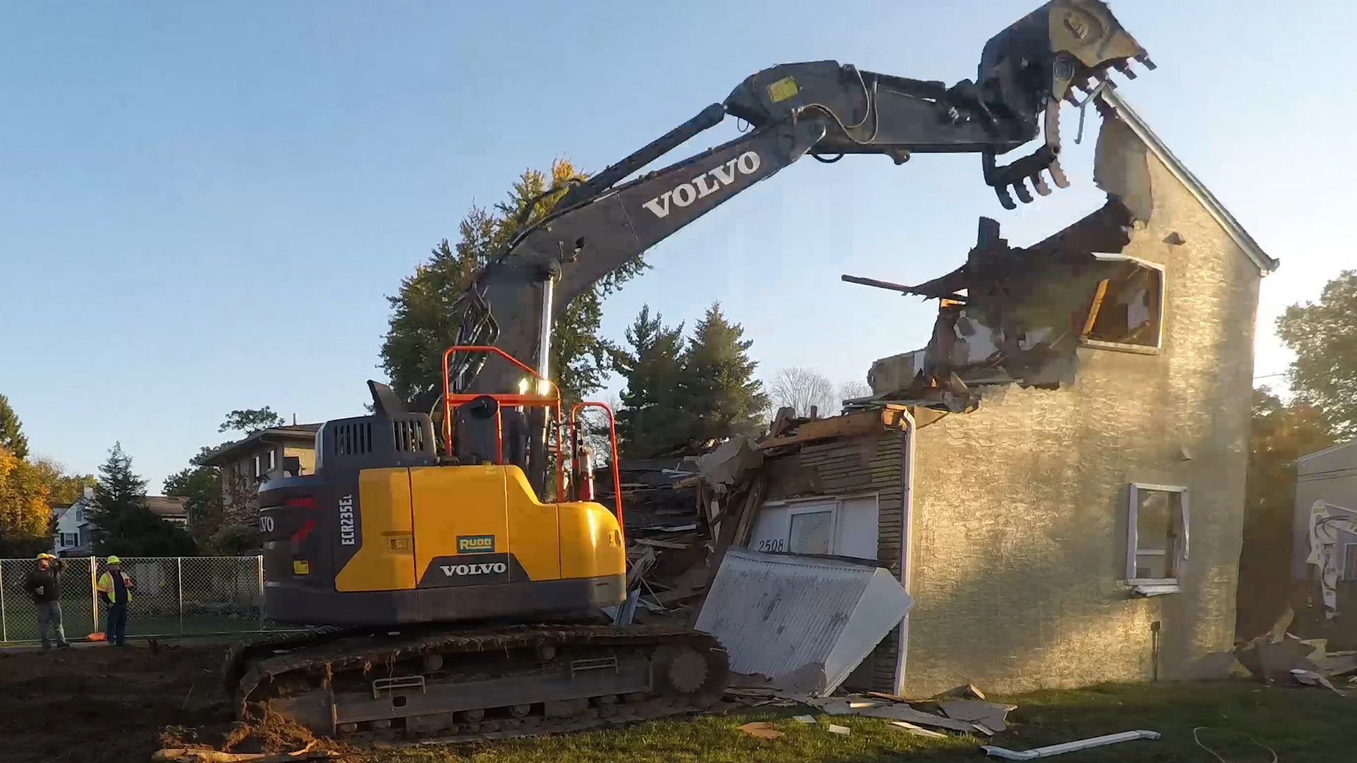An excavator removes the top of a house in Upper Arlington