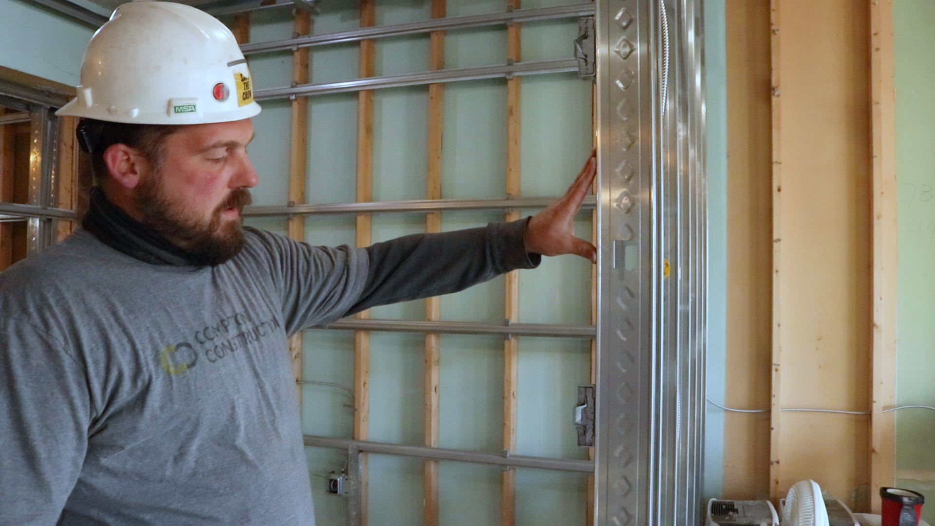 Don demonstrates the floating wall attachments that facilitate soundproofing
